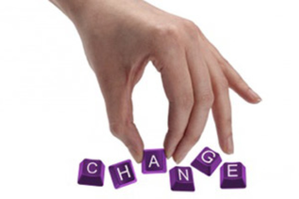 Purple Keyboard keys that spell the word Change, with a picking the letter A